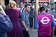 London, UK. Thursday 9th July 2015. Tube and train strikes caused misery for commuters with the entire London Underground network shut down and many rail services cancelled. The strike was in protest at longer working hours announced due to the tube system being open all night on weekends. Some people getting help from a TfL Ambassador.