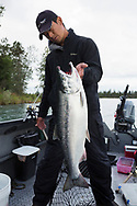 Yuichi Yamao, 46, from Hong Kong with a silver salmon that he caught with a rod and reel in the Kenai River. <br /> <br /> Yamao's salmon record was a king salmon that weighed in at 32.2 kilos (72 pounds).    <br /> <br /> Photographer: Christina Sjögren<br /> <br /> Copyright 2019, All Rights Reserved