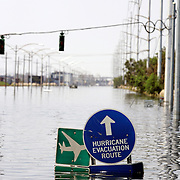 NEW ORLEANS, LA - September 4, 2005:  A hurricane evacuation sign points the way on Airline Way, once a long and wide boulevard, on Sept, 4, 2005 in New Orleans following the destruction caused by Hurricane Katrina. (Photo by Todd Bigelow/Aurora)