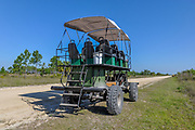 """A swamp buggy awaits its next tour in Big Cypress National Preserve. These custom-built vehicles utilize truck parts, tractor parts, old vehicle seats, welded bars and tarp caopies -- and """"whatever works"""" to create a swamp-worthy touring vehicle for passengers."""