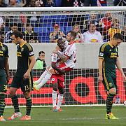 Bradley Wright-Phillips, New York Red Bulls, holds team mate Jonny Steele after Wright-Phillips had scored from the penalty spot during the New York Red Bulls Vs Portland Timbers, Major League Soccer regular season match at Red Bull Arena, Harrison, New Jersey. USA. 24th May 2014. Photo Tim Clayton