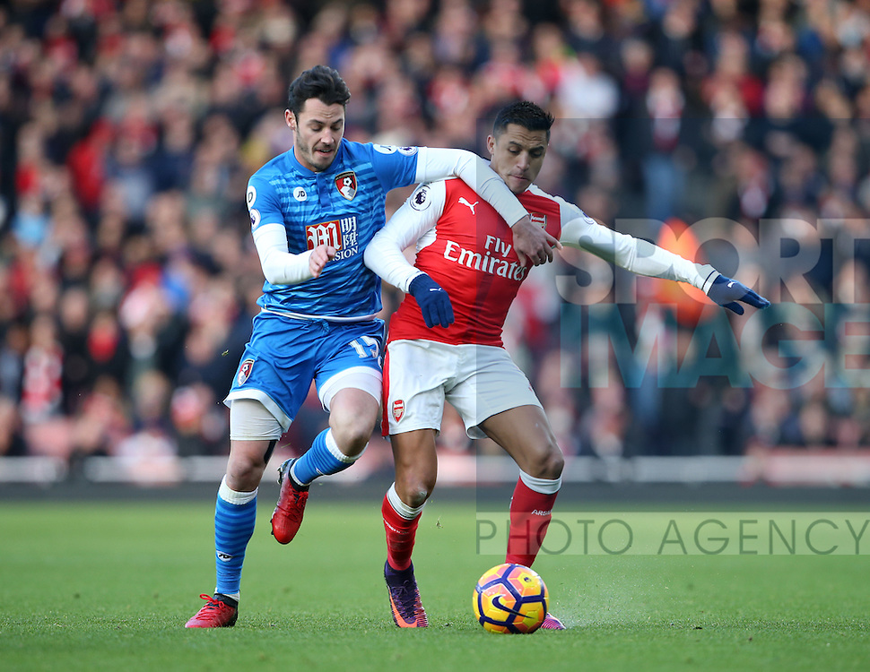 Arsenal's Alexis Sanchez tussles with Bournemouth's Alex Smith during the Premier League match at the Emirates Stadium, London. Picture date October 26th, 2016 Pic David Klein/Sportimage