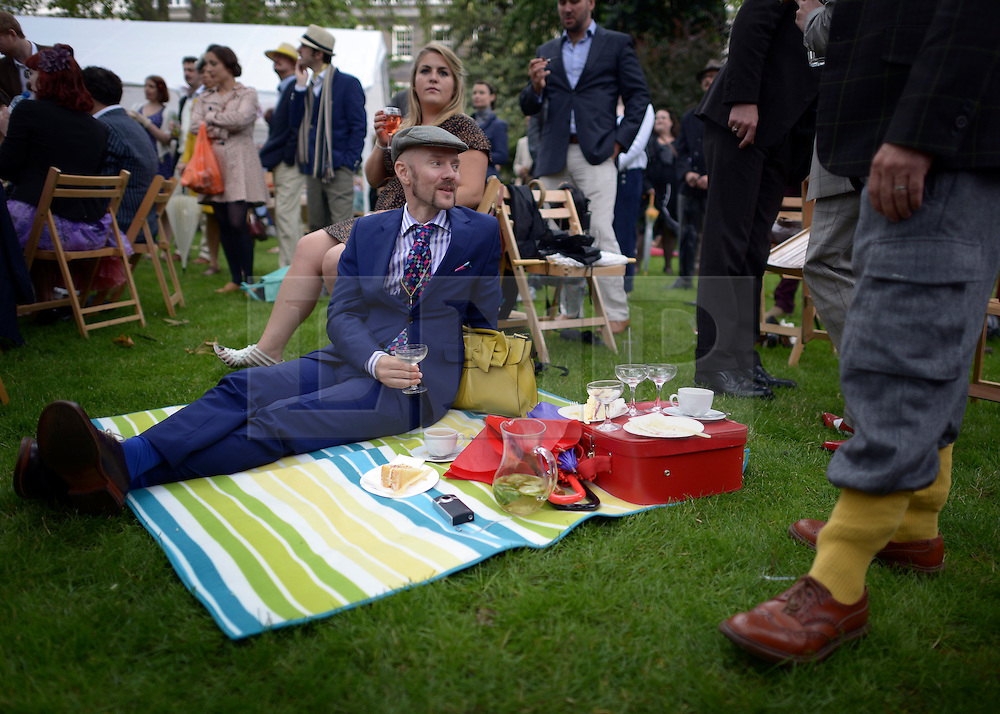 © Licensed to London News Pictures. 07/07/2012. London, UK People picnic at 'The Chap's Olympiad' in central London on July 7th, 2012. 'The Chap' is a light-hearted magazine, aimed at revisiting the fashions and pastimes of the polite aspects of 1920's to 1950's England. The annual Olympiad event sees competitors take part in events such the 'Cucumber Sandwich Discus', 'The Umbrella Joust' and 'The Tug of Hair'e. Photo credit : Stephen Simpson/LNP
