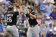 SURPRISE, AZ - MARCH 06:  Jose Abreu #79 of the Chicago White Sox is greeted by Avisail Garcia #26 after hitting a two-run home run, his first as a member of the Chicago White Sox,  against the Kansas City Royals on March 6, 2014 at The Ballpark in Surprise in Surprise, Arizona. (Photo by Ron Vesely)   Subject: Jose Abreu;  Avisail Garcia