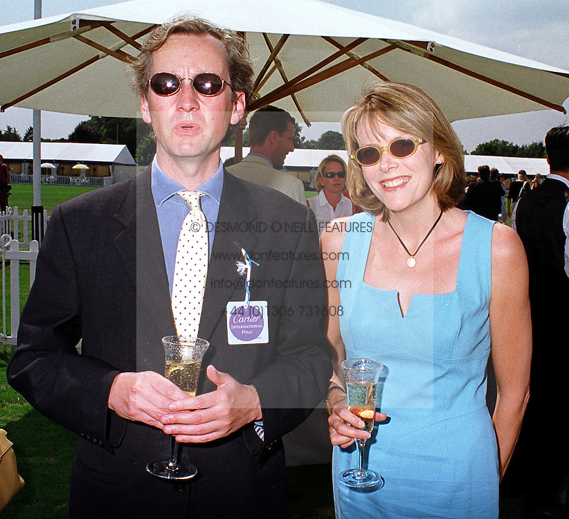 The EARL OF WOOLTON and MISS CAROL CHAPMAN at a polo match in Berkshire on 25th July 1999.MUM 192