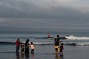 Indonesian tourists mix with surfers at Batu Karas beach on the 31st October 2019 in Java in Indonesia.
