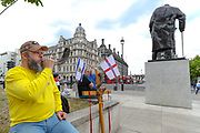 "A religiously motivated Christian man blows a horn in front of Winston Churchill statue beside a cross and English flag. ""I have the horn to warn my patriots to protect our heritage from anarchists,"" he said, during a Black Lives Matter rally in Parliament Square in London, Tuesday, June 9, 2020. Anger against systemic levels of institutional racism has raged through the city, and worldwide; sparked by the death of George Floyd, who was killed in Minneapolis, US, by a policeman who restrained him with force on 25 May 2020. (Photo/ Vudi Xhymshiti)"