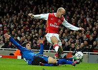 Photo: Ed Godden.<br /> Arsenal v Hamburg. UEFA Champions League, Group G. 21/11/2006. Hamburg's Benny Feilhaber slides in on Freddie Ljungberg.