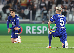 Chelsea's Jorginho (right) and team-mates take a knee prior to kick-off during the UEFA Champions League, Group H match at Allianz Stadium, Turin. Picture date: Wednesday September 29, 2021.