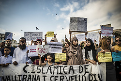August 21, 2017 - Barcelona, Catalonia, Spain - Muslim protestors with their placards condemn the recent jihadist terror attacks in Barcelona and Cambrils which killed 15 people and injured more than 100 shouting slogans at Catalonia Square (Credit Image: © Matthias Oesterle via ZUMA Wire)