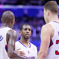 24 March 2014: Los Angeles Clippers guard Chris Paul (3) talks to Los Angeles Clippers forward Blake Griffin (32) and Los Angeles Clippers guard Jamal Crawford (11) during the Los Angeles Clippers 106-98 victory over the Milwaukee Bucks at the Staples Center, Los Angeles, California, USA.