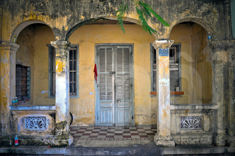 Weathered facade of a French Colonial style house, Vietnam, Southeast Asia