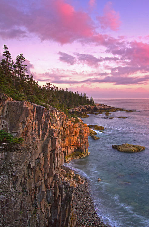 Scenic Coastal Maine seascape photography at sunset featuring a spectacular view across the beautiful cliffs at Raven's Nest along the Acadia National Park coastal shoreline of Schoodic Peninsula. This coastal spot is secretly tucked away in the much less crowded portion of the national park. The area is dramatic and unmarked an unpromoted by the park for obviously reasons. I finally made a return journey to the only area of the national park that is located on main land. With tripod and camera positioned at the edge of the steep Ravens Nest cliffs in front of me and one wrong step away from going down into the ocean I captured Sunset at Raven's Nest.<br /> <br /> Acadia NP is a National Park located in the U.S. state of Maine. It reserves much of Mount Desert Island, and associated smaller islands, off the Atlantic coast. The park is one of the most visited wildlife areas in the United States and a paradise for every photographer and outdoor enthusiast. The park loop road provides easy access to many of the iconic photography subjects, such as Schoodic Peninsula, Monument Cove, Sand Beach, Jordan Pond and the Bubbles, Otter Cliff to name only a few. <br /> <br /> Maine Acadia National Park coastal photography images are available as museum quality photography prints, canvas prints, acrylic prints or metal prints. Prints may be framed and matted to the individual liking and room decor needs:<br /> <br /> http://fineartamerica.com/featured/sunset-at-ravens-nest-juergen-roth.html<br /> <br /> Good light and happy photo making!<br /> <br /> My best,<br /> <br /> Juergen<br /> Licensing: http://www.rothgalleries.com<br /> Photo Prints: http://fineartamerica.com/profiles/juergen-roth.html<br /> Photo Blog: http://whereintheworldisjuergen.blogspot.com<br /> Instagram: https://www.instagram.com/rothgalleries<br /> Twitter: https://twitter.com/naturefineart<br /> Facebook: https://www.facebook.com/naturefineart