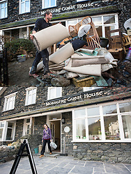 © Licensed to London News Pictures. 11/05/2016. Glenridding UK. FIVE MONTH COMPARISON OF FLOODED VILLAGE OF GLENRIDDING. Top picture taken 10/12/2015 shows the Mosscrag Guest House in Glenridding that was flooded during storm Desmond in December.  Bottom picture taken 10/05/2016 shows the now re-opened Mosscrag Guest House in Glenridding five months on from storm Desmond. The diggers are still in the village of Glenridding five months after storm Desmond hit the area & flooded the village three times last December. Residents of the village have become frustrated at the Environment Agency after it took almost four months for the agency to start work on new flood defences leaving the village looking like a building site during the normally busy tourist period essential to get the area back on it's feet. Photo credit: Andrew McCaren/LNP