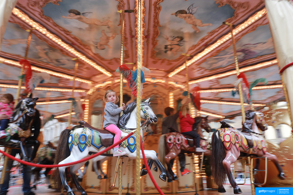 FLORENCE, ITALY - NOVEMBER 01: A young girl riding the antique carousel of the Picci Family operating in the Piazza della Republica in Florence. The carousel dates from the beginning of the 20th century but has been lovingly restored and operates outside the tourist season. Florence, Italy, 1st November 2017. Photo by Tim Clayton/Corbis via Getty Images)