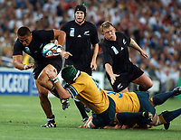 Photo. Steve Holland.Australia v New Zealand, Semi-final at the Telstra Stadium, Sydney. RWC 2003.<br />15/11/2003.<br />NZ's Jerry Collins, left is tackled by Australia's Elton Flatley.