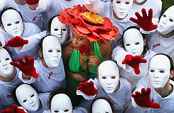 Model Joyce Matemba with students dressed as mannequins to illustrate Africa's faceless, voiceless majority to mark World Aids Day in the gardens of Mansion House, Dublin.