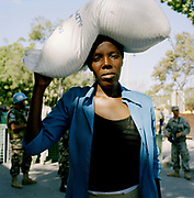 Chanette Inocent Jeremie in an aid queue at  Petion-Ville. On Tuesday 12th of January at 16.53pm local time the biggest Earthquake to hit Haiti for 200 years struck with devastating force. 230,000 people were killed, 300,000 injured and 1.2 million left needing emergency shelter. Survivors have lost family, homes, livelihoods and essential services. Hospitals, schools and government buildings were also destroyed'. These pictures are of the survivors three weeks later.