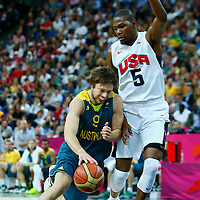 08 August 2012: Australia Matt Dellavedova drives past USA Kevin Durant during 119-86 Team USA victory over Team Australia, during the men's basketball quarter-finals, at the 02 Arena, in London, Great Britain.