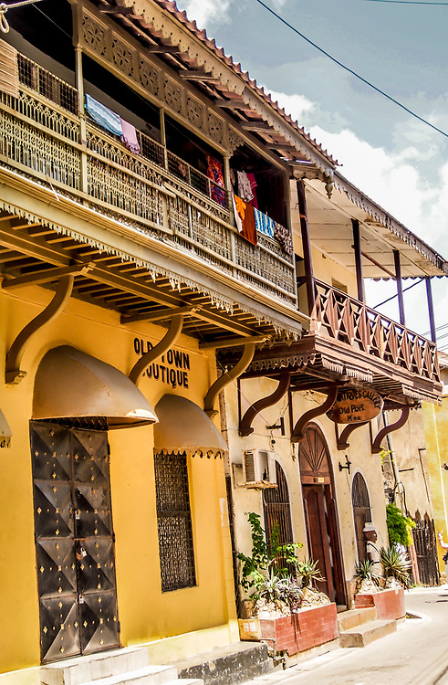 House in Old Town in Mombasa, Kenya. Historical buildings that date from the 18th century combine several influences like Arabic, African and European. Beautifully carved doors and elegantly styled balconies tell the story of the wealth of the owners.