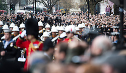 © London News Pictures.17/04/2013. London, UK.  Members of the public line the streets outside St Paul's Cathedral in London for The Funeral of former British Prime Minister, Margaret Thatcher on April 17, 2013. Photo credit : Ben Cawthra/LNP