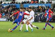Joel Ward of Crystal Palace has a shot, during the Premier League match between Swansea City and Crystal Palace at the Liberty Stadium, Swansea, Wales on 26 November 2016. Photo by Andrew Lewis.