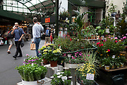 Flowers and plants stall at Borough Market in London, England, United Kingdom. Borough Market is a retail food market and farmers market in Southwark. It is one of the largest and oldest food markets in London, with a market on the site dating back to at least the 12th century. A farmers market is a physical retail marketplace intended to sell foods directly by farmers to consumers. Farmers markets may be indoors or outdoors and typically consist of booths, tables or stands where farmers sell fruits, vegetables, meats, cheeses, and sometimes prepared foods and beverages.
