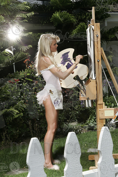 22 June 2005:  Stacia Raystone-Robitaille paints a picture of her husband Luc Robitaille in their front yard in Beverly Hills during The Not so Desperate, Desperate housewives shoot on location in Los Angeles with NHL hockey players wives for Editorial Use Only!  Mandatory Credit:  Shelly Castellano.com or Price Doubles. .
