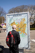 Man looking at map, Den Burg, Texel, Netherlands,