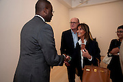 Tidjane Thiam;  David Ciclitira; Serenella Ciclitira, Indonesian Eye Contemporary Art Exhibition Reception, Saatchi Gallery. London. 9 September 2011. <br /> <br />  , -DO NOT ARCHIVE-© Copyright Photograph by Dafydd Jones. 248 Clapham Rd. London SW9 0PZ. Tel 0207 820 0771. www.dafjones.com.