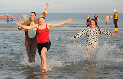 © Licensed to London News Pictures. 26/12/2013<br /> <br /> Redcar, Cleveland, United Kingdom<br /> <br /> Hundreds of swimmers many in fancy dress brave the cold North Sea to take part in the annual Boxing Day dip on the beach in Redcar, Cleveland to help raise money for a number of different charities.<br /> <br /> Photo credit : Ian Forsyth/LNP