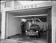 20/07/1962<br /> 07/20/1962<br /> 20 July 1962<br /> Shell Service Station at Merrion Road, Dublin. Picture shows a view of Dorden's service station's car wash. Car is a Skoda.