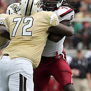 UCF Knights offensive linesman Torrian Wilson (72) and South Carolina Gamecocks defensive end Jadeveon Clowney (7) during an NCAA football game between the South Carolina Gamecocks and the Central Florida Knights at Bright House Networks Stadium on Saturday, September 28, 2013 in Orlando, Florida. (AP Photo/Alex Menendez)
