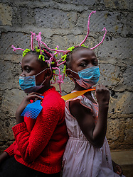 May 9, 2020: 12 year old Martha Apisa (left) and her close neighbor 8 year old Stacy Ayuma (Right), are seen using their hair style braids to create awareness and sensation about the Corona Virus. (Credit Image: © Donwilson Odhiambo/ZUMA Wire)