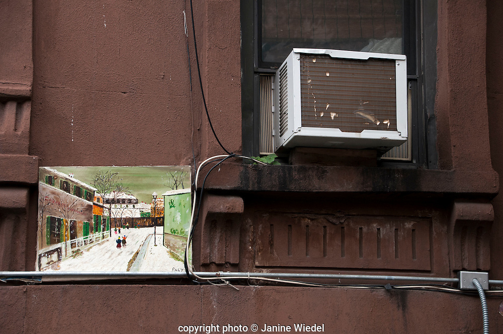 Air conditioner and painting on exterior of Harlem home New York