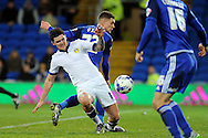 Leeds United's Alex Mowatt (white shirt) is challenged by Cardiff City's Stuart O'Keefe. Skybet football league championship match, Cardiff city v Leeds Utd at the Cardiff city stadium in Cardiff, South Wales on Tuesday 8th March 2016.<br /> pic by Carl Robertson, Andrew Orchard sports photography.
