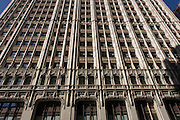 The Woolworth Building, at 233 Broadway, Manhattan, New York City, designed by architect Cass Gilbert and completed in 1913, is an early US skyscraper, designed in the neo-Gothic style by the architect Cass Gilbert for the company's new corporate headquarters on Broadway,  opposite City Hall. Originally designed to be 420 feet (130 m) high, the building was eventually elevated to 792 feet (241 m). At its opening, the Woolworth Building was 60 stories tall and had over 5,000 windows.