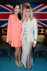 Left to right, YASMIN MILLS and JO WOOD at a summer party hosted by Jo Wood & Yasmin Mills at Boujis, 43 Thurloe Street, London on 9th July 2014.