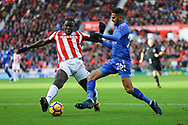 Kurt Zouma of Stoke City (l) tackles Riyad Mahrez of Leicester City. Premier league match, Stoke City v Leicester City at the Bet365 Stadium in Stoke on Trent, Staffs on Saturday 4th November 2017.<br /> pic by Chris Stading, Andrew Orchard sports photography.