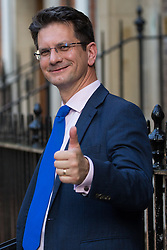 London, UK. 23 July, 2019. Steve Baker MP, Deputy Chair of the pro-Brexit European Research Group (ERG), gives a thumbs-up after attending a celebration in Westminster of Boris Johnson's election as Conservative Party leader and replacement of Theresa May as Prime Minister organised by the ERG.