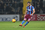 Scott Wiseman of Scunthorpe United kicks forward during the Sky Bet League 1 match between Scunthorpe United and Barnsley at Glanford Park, Scunthorpe, England on 31 October 2015. Photo by Ian Lyall.
