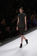 a black tone-on-tone shorts and cap-sleeved top outfit by Richard Chai at the Spring 2013 Mercedes Benz Fashion Week show in New York.