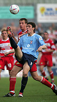 Photo. Andrew Unwin<br /> Doncaster Rovers v York, Nationwide League Division Three, Earth Stadium, Belle Vue, Doncaster 24/04/2004.<br /> Doncaster's Chris Brown (l) closes in on York's Chris Smith (r).