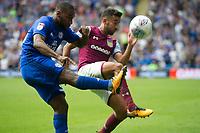 Football - 2017 / 2018 Championship - Cardiff City vs. Aston Villa<br /> <br /> <br /> Junior Hoilett of Cardiff City clears despite the challenge of Neil Taylor of Aston Villa, at Cardiff City Stadium<br /> <br /> COLORSPORT/WINSTON BYNORTH