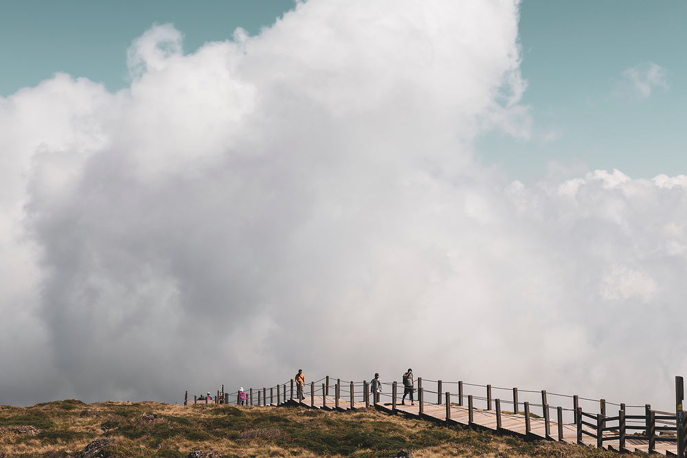 Hallasan National Park, South Korea - September 16, 2019: In Hallasan National Park, hikers walk the final few meters before arriving at the summit of Hallasan, South Korea's largest mountain, located on the island of Jeju.
