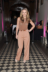 Singer KIMBERLEY WALSH at a fashion show by Catherine Walker & Co in support of The Haven held at One Mayfair, North Audley Street, London on 18th May 2011.