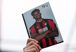 A matchday programme is held aloft before the Premier League match at the Vitality Stadium, Bournemouth.