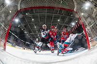 KELOWNA, BC - JANUARY 31: Kaedan Korczak #6 and Cole Schwebius #31 of the Kelowna Rockets defend the net as Leif Mattson #28 of the Spokane Chiefs looks for the rebound at Prospera Place on January 31, 2020 in Kelowna, Canada. (Photo by Marissa Baecker/Shoot the Breeze)