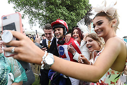 Love Island's Chris Hughes poses for pictures after The Best Western Hotels & Macmillan Ride of their Lives, during the Macmillan Charity Raceday at York Racecourse.