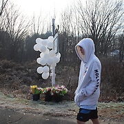 A  teenage boy after laying flowers at the Sandy Hook Elementary School sign in Sandy Hook after yesterday's shootings at Sandy Hook Elementary School, Newtown, Connecticut, USA. 15th December 2012. Photo Tim Clayton